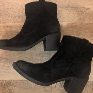 Black boots with a worn look